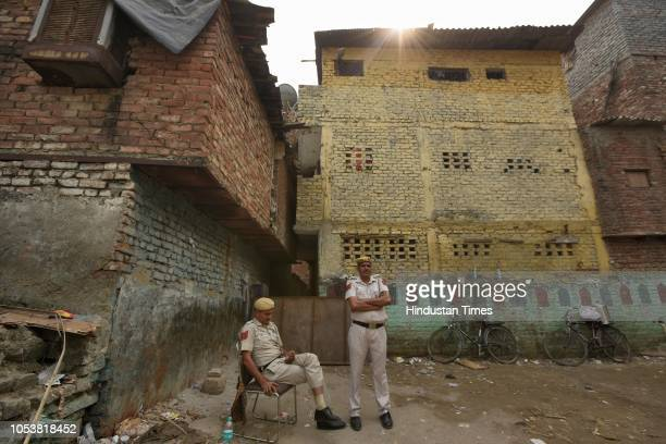 Police force inside the compound of a mosque after an eightyearold student of a Madrasa died after he sustained a head injury during a scuffle...