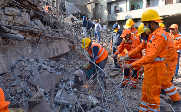 Police Force NDRF and Army personnel participating in rescue operations on the third day after a five storied building collapsed at Mushtaq Gunj area.