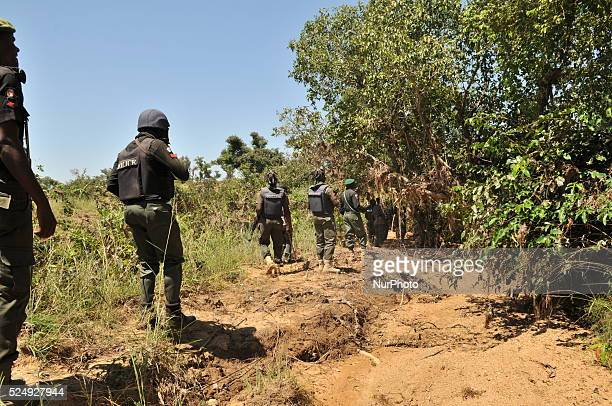 Police force officers on search at the Dajin Gomo Village of Sumaila local government area where Kano State police command found some stolen cows...