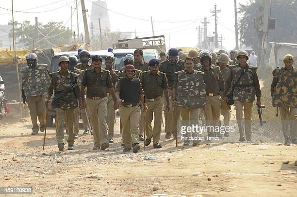 Police force patrolling the area after violence by mob angry after houses demolished in anti-encroachment drive by Greater Noida Authority at Kulsera...