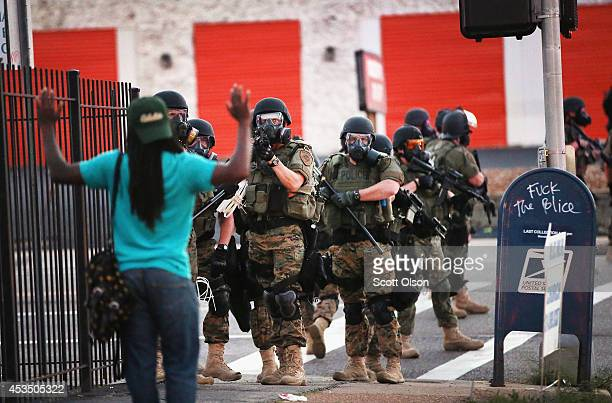 Police force protestors from the business district into nearby neighborhoods on August 11 2014 in Ferguson Missouri Police responded with tear gas...