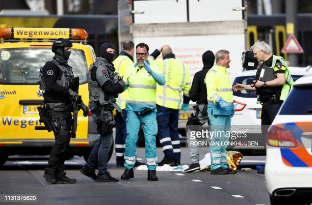 Police forces and emergency services stand at the 24 Oktoberplace in Utrecht, on March 18, 2019 where a shooting took place. - Several people were...