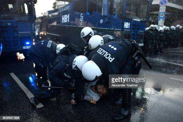 Police Forces clash with protesters during a march on July 7 2017 in Hamburg Germany Leaders of the G20 group of nations are arriving in Hamburg...