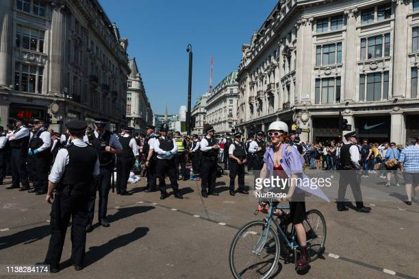 Police forces cordon off Oxford Circus as they remove and arrest Extinction Rebellion demonstrators blocking the junction on day six of protest...