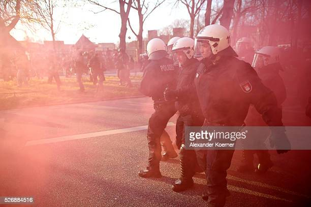 Police forces guard leftist protesters during a march on May Day on 01 May 2016 in Hamburg Germany Tens of thousands of people across Germany...