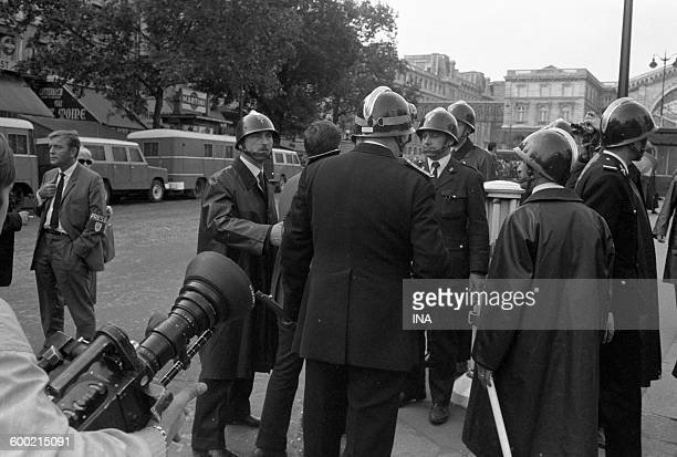 Police forces in situation in a street of Paris, during a demonstration in May, 68.