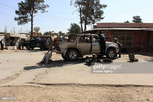 Police forces inspect the area after the car bomb attacks in the province of Cevizcan on the west of Balkh killed at least 3 people and wounded many...