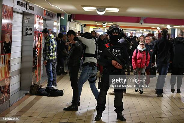 Police forces make searches inside the North station on March 22 2016 in Brussels as stations are opened again with high security measures after a...