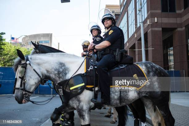Police forces on their horses prepare for a Ku Klux Klan rally at city square in Dayton Ohio More than 600 counter protesters showed up to the event...