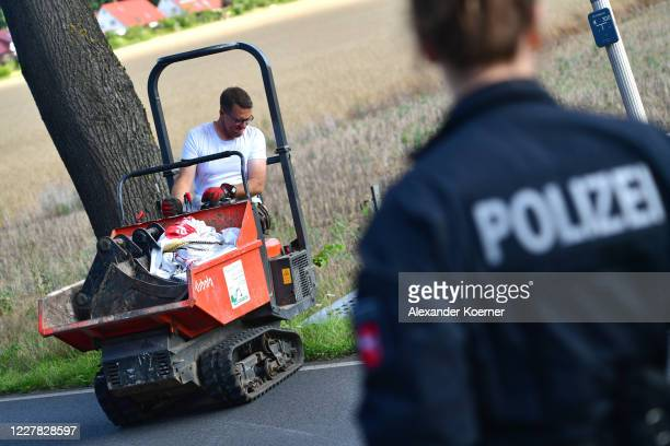 Police forces remove heavy machinery from the allotment, which was searched for two days in relation to the disappearance of Madeleine McCann, on...