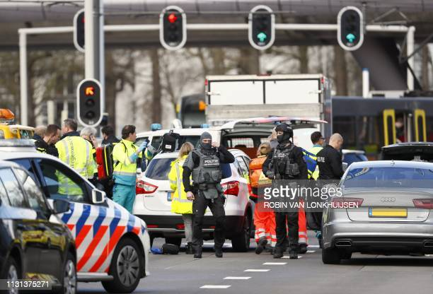 Police forces stand at the 24 Oktoberplace in Utrecht, on March 18, 2019 where a shooting took place. - Several people were wounded in a shooting on...