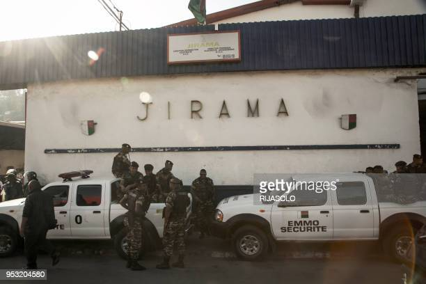 Police forces stand guard during an anti-government demonstration in front of a plant of the public water and electricity supply company JIRAMA, in...