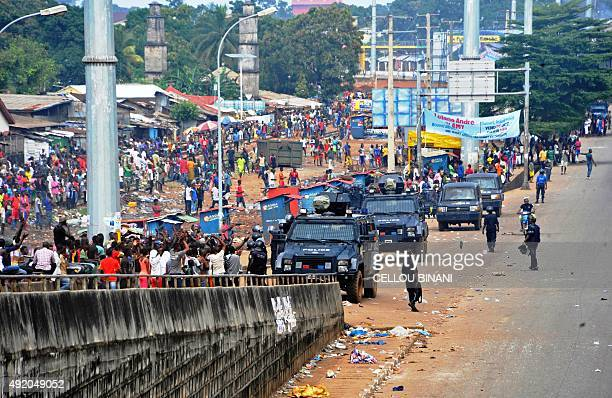 Police forces stand guard near the Niger marketplace in Conakry on October 9 2015 Tensions flared in Guinea ahead of Sunday's presidential election...