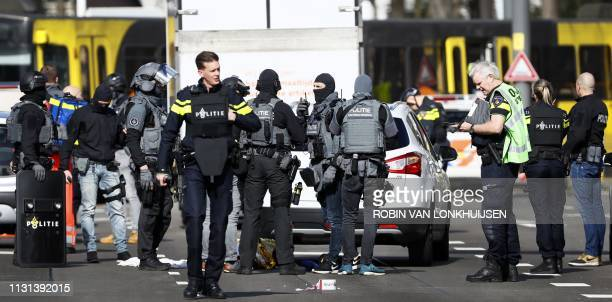 Police forces stand near a tram at the 24 Oktoberplace in Utrecht on March 18 2019 where a shooting took place A gunman who opened fire on a tram in...