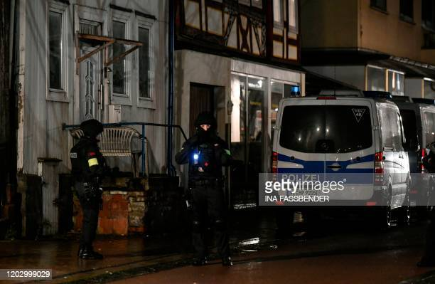 Police forces stand near the house of a driver who steered his car into a carnival procession February 24 2020 in Volkmarsen near Kassel central...