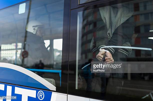 Police forces take a protestor into custody during a demonstration against a party congress of the German right wing party AfD at the Stuttgart...