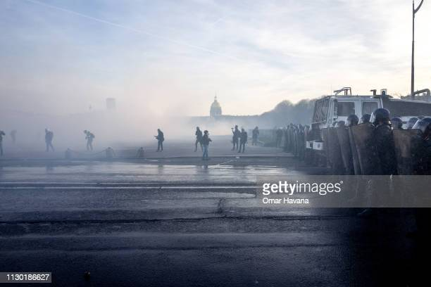 Police forces take positions in a midst of tear gas during clashes with protesters in 'Les Invalides' during the Act 14 protest called by the Gilets...
