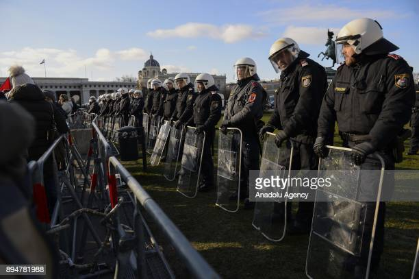 Police forces take security measures during a demonstration against the new Austrian government during the swearingin day at Heldenplatz Vienna...