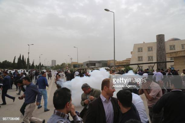 Police forces use teargas to disperse hundreds of civil servants who gathered near Sanedar Park to walk towards the government headquarters during a...