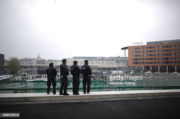 Police forces watch righwing protesters at the central Trainstation Hanover on November 15 2014 in Hanover Germany HoGeSa which stands for 'Hooligans...