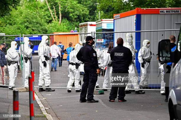 Police forces wearing full protective suits prepare to enter the high-rise apartment building, as tensions between residents and authorities rise,...