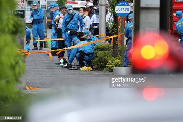 TOPSHOT Police forensic experts investigate a crime scene where a man stabbed 19 people including children in Kawasaki on May 28 2019 Two people...