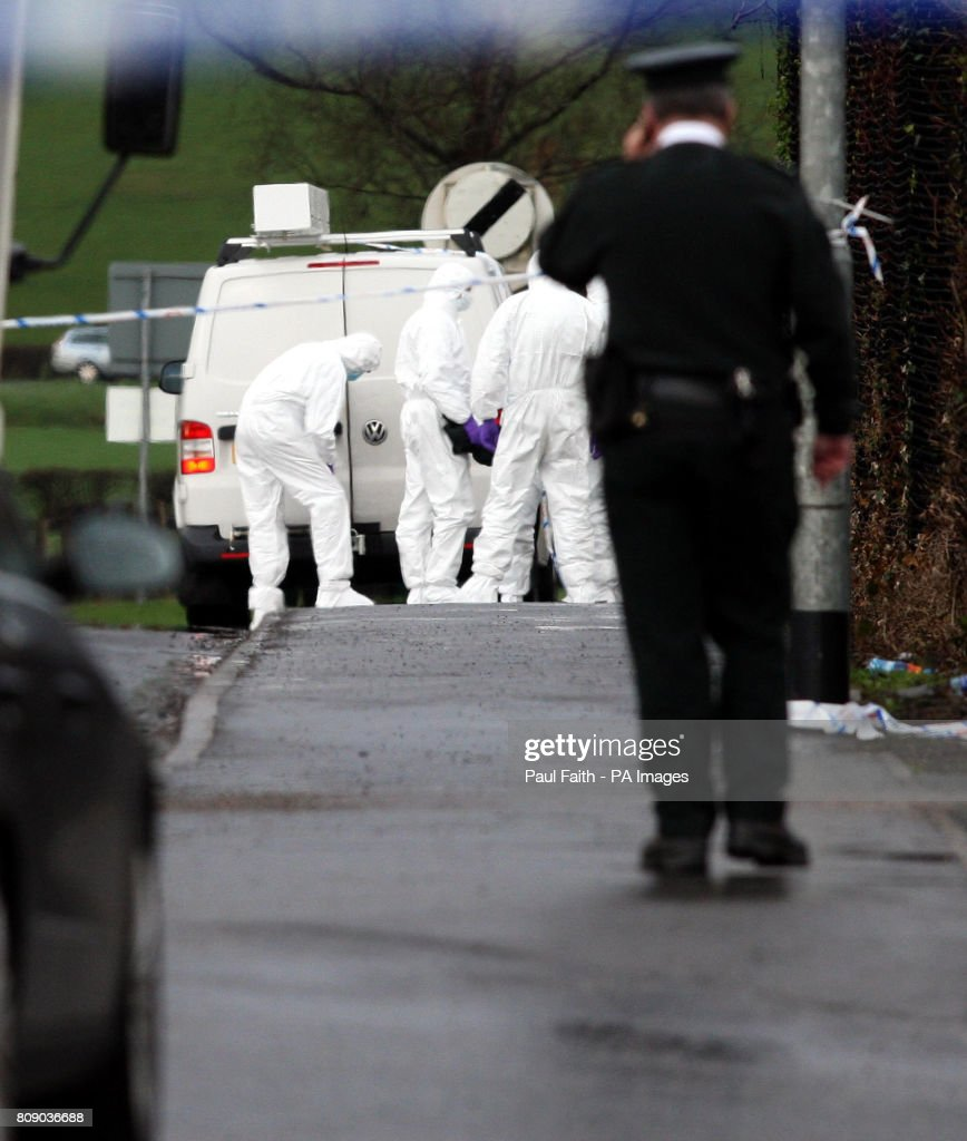 Police forensic experts move into examine the area where a policeman was killed in an under car booby trap explosion, in Omagh Co Tyrone today.