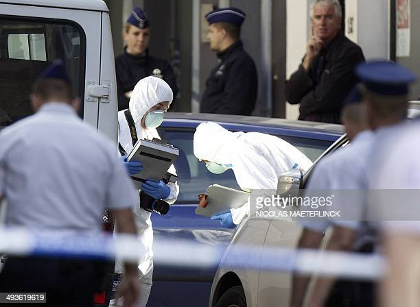 Police forensic experts search for evidence on the scene of a shooting near the Jewish Museum in Brussels on May 24 2014 Three people were killed and...