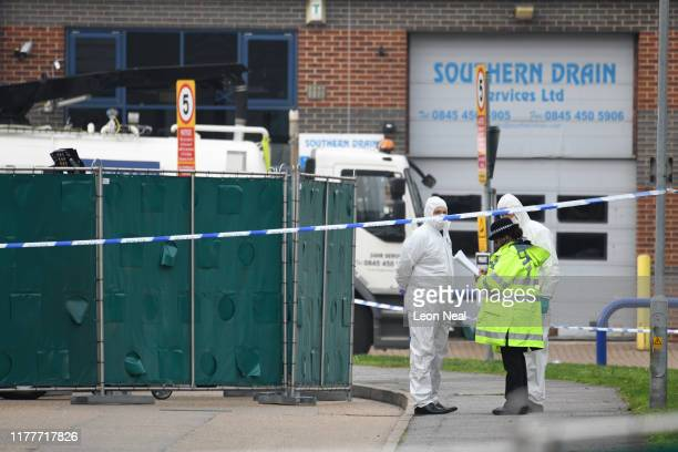 Police forensic investigation officers stand near the site where 39 bodies were discovered in the back of a lorry on October 23, 2019 in Thurrock,...