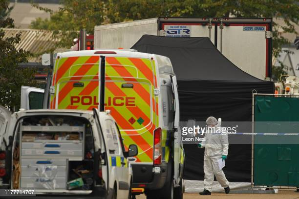 Police forensic investigation team are parked near the site where 39 bodies were discovered in the back of a lorry on October 23, 2019 in Thurrock,...