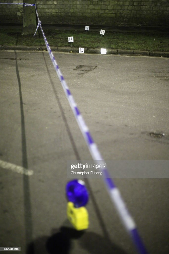 Police forensic markers are placed at reference points outside Elmfield Park, Doncaster, following the death of a 13-year-old girl on February 15, 2012 in Doncaster, England. Police investigating the murder are questioning a 26year-old woman who remains in police custody.
