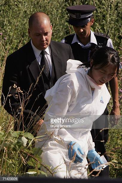 Police forensic officer an undertaker and a community support officer leave woodland near to the home of a missing man allegedly Neil Coulbeck...
