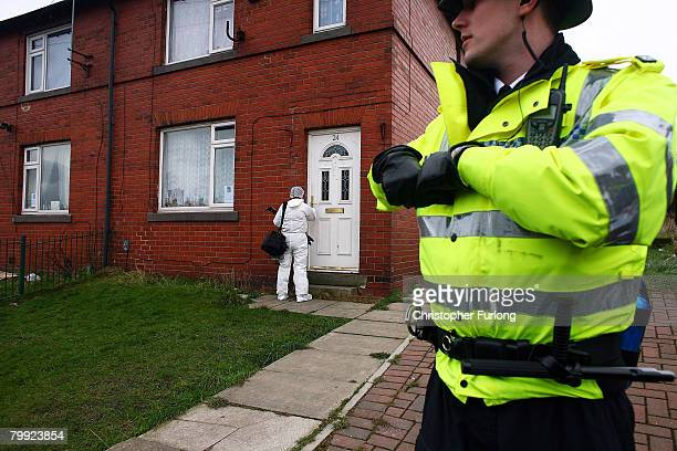 A police forensic officer enters the home of missing nineyearold Shannon Matthews of Dewsbury near Leeds on February 20 Dewsbury England Shannon has...
