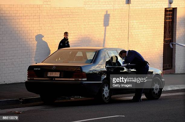 Police forensic officer examines the car of underworld figure Desmond 'Tuppence' Moran who was shot dead earlier today, at Ascot Vale on June 15,...