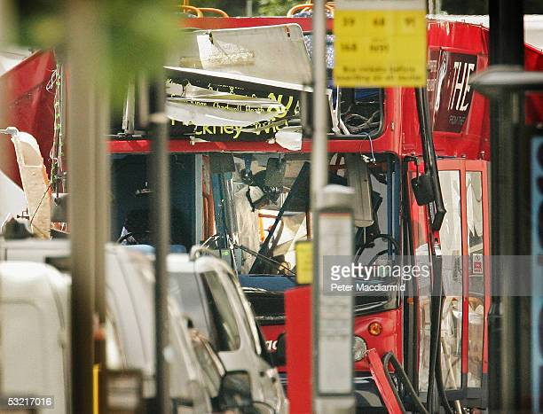 A police forensic officer is seen inside the bombed bus in Tavistock Square on July 9 2005 London At least 49 people were killed and 700 injured...