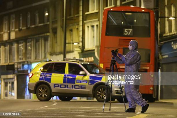 Police forensic officer works on Streatham High Road in south London on February 2 after a man is shot dead by police following reports of people...