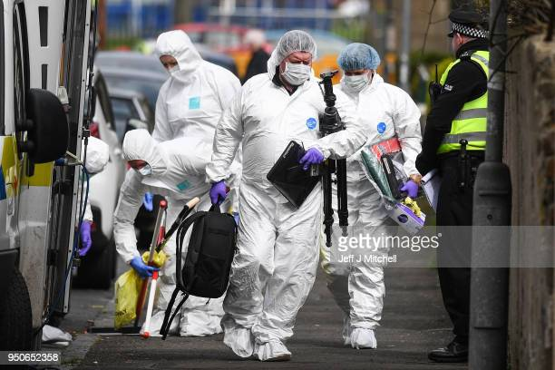 Police forensic officers arrive at a house in Drumoyne where they are investigating the death of 47yearold Julie Reilly on April 24 2018 in Glasgow...