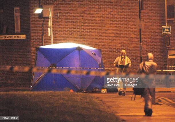 Police forensic officers at the scene of a stabbing incident in Invermore Place in Woolwich southeast London where a young man died today