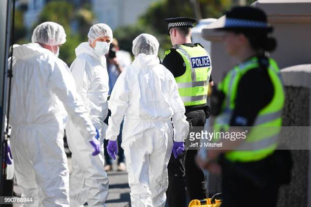 Police forensic officers enter a house on Ardbeg Road following the discovery of the body of sixyearold Alesha MacPhail on July 3 2018 on the Isle of...