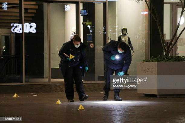Police forensic officers examine the scene at the Grote Marktstraat in The Hague, The Netherlands on November 29, 2019 after several people were...