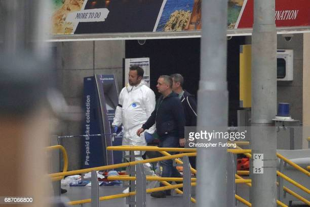 Police forensic officers investigate the scene of an explosion at Victoria Station on May 23 2017 in Manchester England An explosion occurred at...