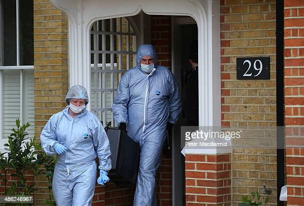 Police forensic officers leave a house in New Malden where the bodies of three children were found on April 23 2014 in south London England Police...