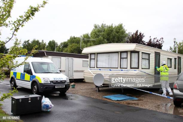 Police forensic officers on the scene of a fatal stabbing at Stud Farm Holiday Park in Heysham Lancashire
