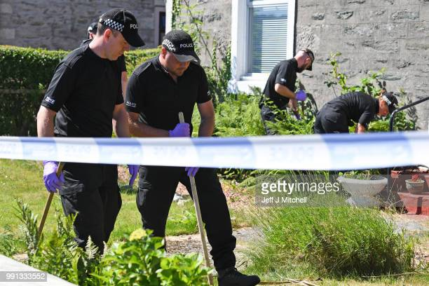 Police forensic officers search a garden at a house on Ardbeg Road on the Isle of Bute following the conformation that six year old schoolgirl Alesha...