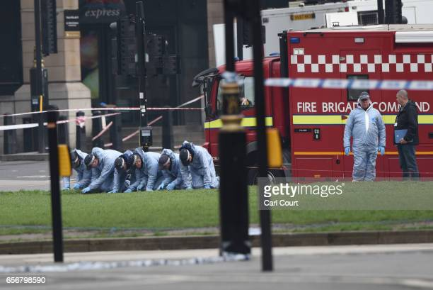 Police forensic officers work in Parliament Square following yesterday's attack on March 23 2017 in London England Four people including the...