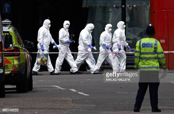Police forensic officers work near Borough Market in London on June 4 as police continue their investigations following the June 3 terror attack...