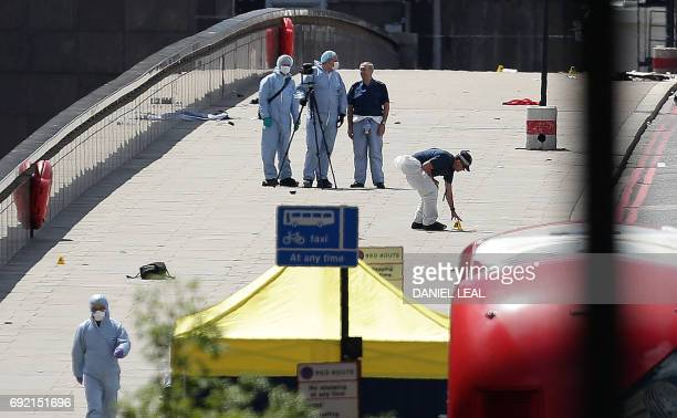 Police forensic officers work on London Bridge in London on June 4 as police continue their investigations following the June 3 terror attack Seven...