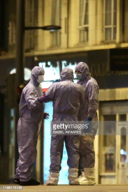 Police forensic officers work on Streatham High Road in south London on February 2 after a man is shot dead by police following reports of people...