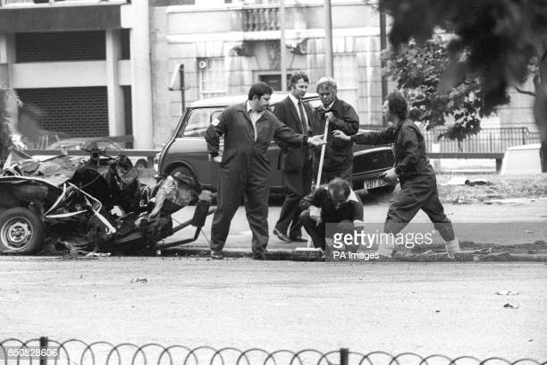 Police forensic officers working on the remains of the IRA car which housed yesterday's Hyde Park car bomb Detectives are trying to trace the owner...
