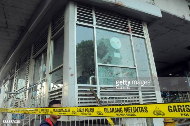 Police forensic research team with tight security conducted crime scene at the site of the explosion of two suicide bombs at the bus selter of...